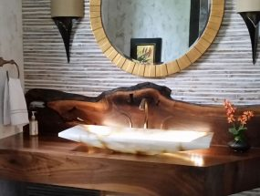 Walnut vanity with live edge backsplash, inlays